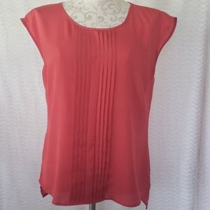 Coral colored blouse